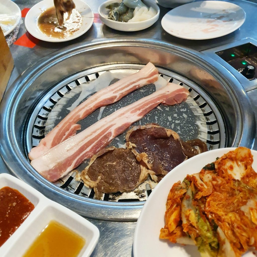Meats Grilling on the Korean BBQ Grill installed into the table